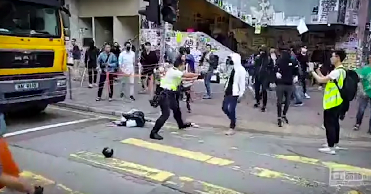 In Hong Kong, Police Shot a Man While Protesters Set Another on Fire