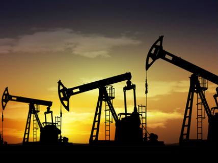 OilWellsAtSunsetDreamstimeWarenemy
