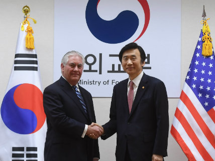 South Korean Foreign Minister Yun Byung-se (R) shakes hands with U.S. Secretary of State Rex Tillerson in South Korea on March 17