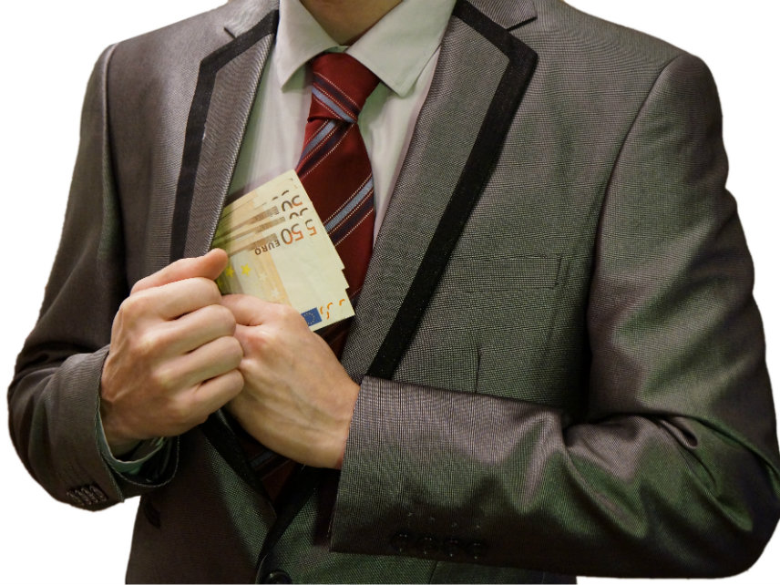 Corrupt man in a suit putting euro banknotes into his pocket.
