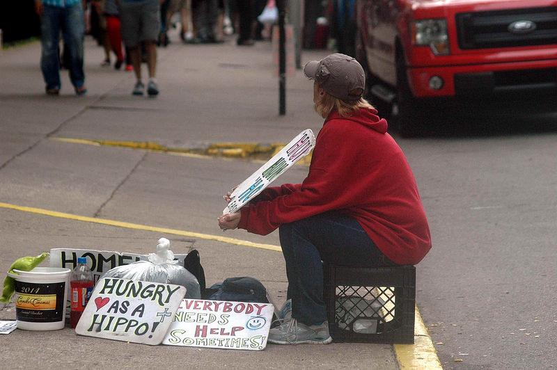 beggar on crate