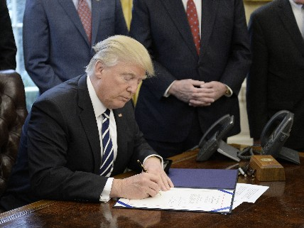 Trump signs executive order.
