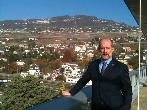 This is a picture I took, from the smoking balcony of worldwide Nestle HQ, of Cato's Jim Harper posing proudly in front of Mont Pelerin