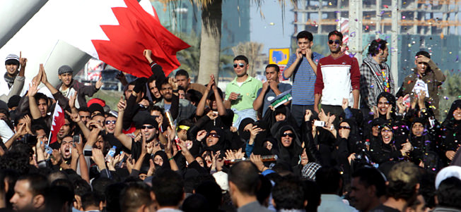 Protesting Bahraini women wear sunglasses, like common whores.