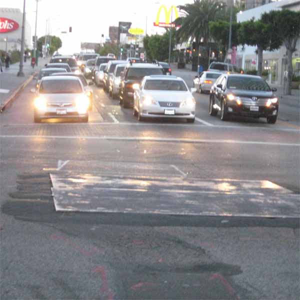 This jagged metal sheet is good enough for Wilshire and Western. It's not like that intersection gets a lot of traffic.
