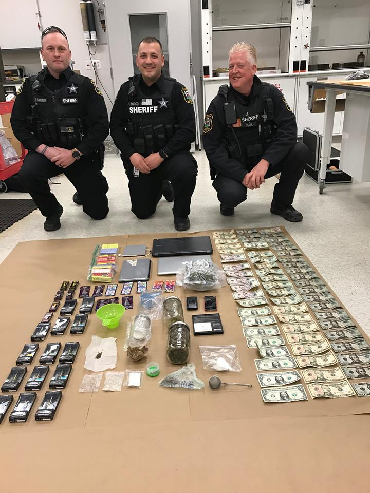 Brave Cops Pose With Drugs, 'Paraphernalia,' and a Single